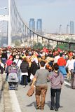 Walking on the bridge. Participants run over streets during the 32nd Intercontinental Eurasia Marathon run on October 17, 2010 in Istanbul, Turkey Royalty Free Stock Images