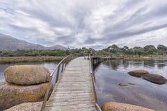 Walking bridge across a river Royalty Free Stock Photo