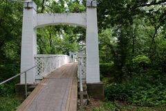 Walking Bridge. This footbridge was quietly tucked away in a park. People and their dogs use this bridge quite frequently Stock Photo