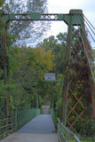 Walking bridge heading into park Royalty Free Stock Photo