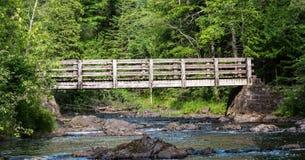 Walking Bridge over the Black River Stock Photography
