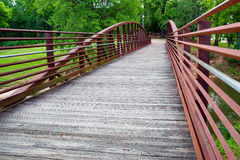 Walking bridge in park Royalty Free Stock Images