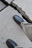 Walking on Broken Dangerous Sidewalk Royalty Free Stock Image