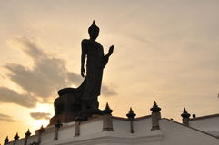 Walking buddha with silhouete background Royalty Free Stock Photo