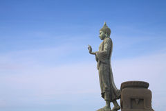 Walking Buddha statue. With blue sky, Thailand Royalty Free Stock Photo