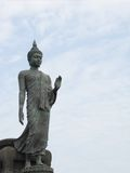 Walking buddha statue Royalty Free Stock Images