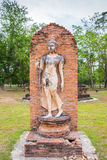 Walking Buddha statue in Sukhothai Historical Park Stock Photos