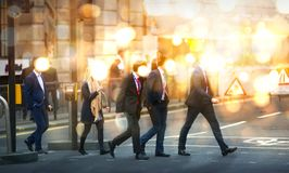 Multiple exposure image of walking people in London. Business concept illustration. Walking business people. Multiple exposure image. Business concept Stock Image