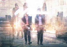 Multiple exposure image of walking people in London. Business concept illustration. Walking business people. Multiple exposure image. Business concept Stock Photo