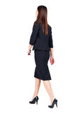 Walking Business Woman. Back View. Royalty Free Stock Image
