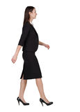 Walking business woman. back view. Royalty Free Stock Photo
