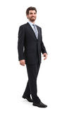 Walking Businessman. Smiling businessman is walking. Isolated on white background Stock Images
