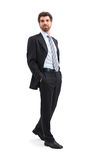 Walking Businessman. Young businessman is walking and looking away with his hands in his pockets. Isolated on white background Royalty Free Stock Photo