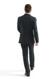 Walking businessman in black suit Stock Image