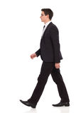 Walking businessman in black suit. Stock Photos