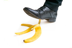 Walking businessman is going to slip on banana peel Royalty Free Stock Photos