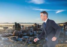 Walking businessman over city. Digital composite of Walking businessman over city Stock Photography