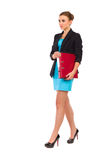 Walking businesswoman with ring binder. Stock Photo