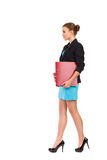 Walking businesswoman. Side view. Stock Photography