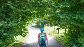 Walking on Camino de Santiago. Woman walking on Camino de Santiago royalty free stock image