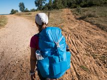 Walking on Camino de Santiago. Woman walking on Camino de Santiago royalty free stock photos