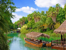 Walking canoe on river in French Polynesia. Stock Photo