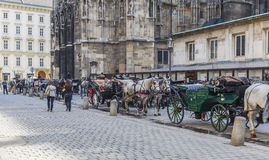 Walking carriage in front of the. AUSTRIA,VIENNA - APRIL 17,2016:Walking carriage in front of the cathedral of St. Stephen in Vienna Stock Photo