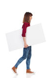 Walking Casual Girl Carrying White Placard Stock Photos