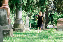 Walking in Cemetery Stock Image