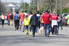 Walking for Charity. This image show people walking for a cure Stock Photo