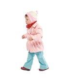 Walking child. Child walking with pink jacket. Isolated on white Royalty Free Stock Photo