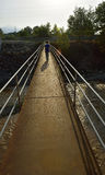 Walking child on the suspension bridge Royalty Free Stock Photos