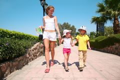 Walking with children stock images