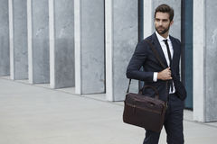 Walking in city. Businessman with briefcase walking in city Royalty Free Stock Images