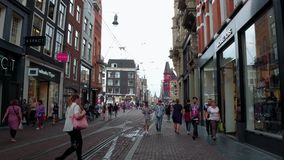 Walking through the city center if Amsterdam - typical street view - AMSTERDAM - THE NETHERLANDS - JULY 19, 2017. Walking through the city center if Amsterdam stock video