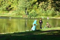 Kaliningrad, Russia - october 2018: Boys fishing at central park lake royalty free stock photo