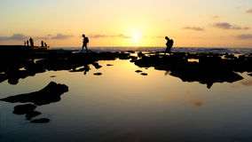 Holiday palinuro picture,silhouette,Walking,cliff,sunset viewing,backlight. Couple walking along a seaside cliff at sunset.holiday Image Royalty Free Stock Images