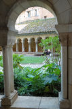 Walking in a cloister. View of a cloister garden through arcade and colonnade. Albi -France Royalty Free Stock Photos
