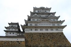 Walking closer to Himeji Castle that`s also called. `White Heron` located on a hilltop on a cloudy day. Pic was taken in August 2017 Stock Image