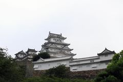 Walking closer to Himeji Castle that`s also called. `White Heron` located on a hilltop on a cloudy day. Pic was taken in August 2017 Royalty Free Stock Photos