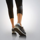 Walking. Closeup woman's legs walking, Isolated on grey background Stock Images