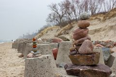 Stones pyramid on amber beach of Baltic sea stock image