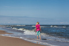 Walking at the coast Stock Images
