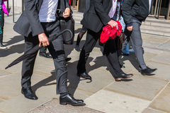 Walking commuters at rush hour Stock Images