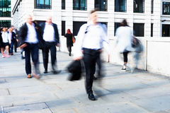 Walking commuters at rush hour Royalty Free Stock Photo