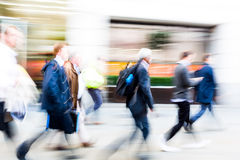 Walking commuters at rush hour Royalty Free Stock Image