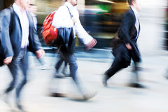Walking commuters at rush hour Royalty Free Stock Images