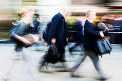 Walking commuters at rush hour Stock Photo