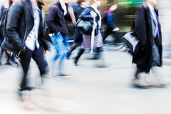 Walking commuters at rush hour Stock Photos
