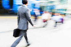 Walking commuters at rush hour Stock Image
